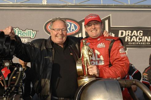 How Conrad Kalitta looks when he is happy; celebrating a Top Fuel win with Doug Kalitta
